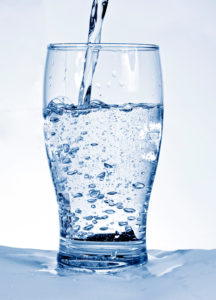 Water flowing in a glass